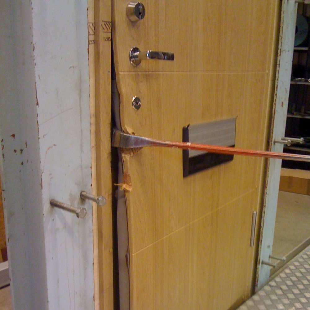 11_Door being forced on lock side with crowbar