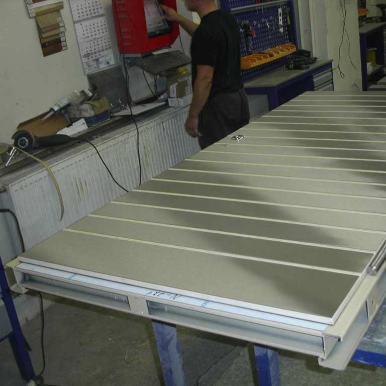 03_door assembly specialist logs completion of stainless steel finished security door